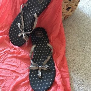 Reef flip flops with bow tie